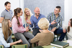 Professor consulting different age students royalty free stock photos