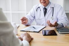 Professor Doctor consulting with patient discussing something and recommend treatment methods, Presenting results on report, stock photos