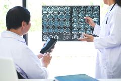Professor Doctor discussing and consulting method with patient t. Reatment results on brain x-ray film About the problem of the patient stock photo