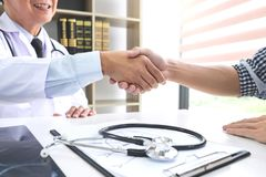 Professor Doctor having shaking hands with patient after recomme royalty free stock photography