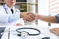 Professor Doctor having shaking hands with patient after recommend treatment method while discussing explaining his symptoms or c stock photos