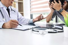 Professor Doctor having support and comforting in recommend with patient while discussing explaining his symptoms or counsel royalty free stock photo