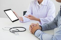 Professor Doctor presenting report and recommend a method. Professor Doctor presenting report and recommend a method with patient treatment on digital tablet Royalty Free Stock Photos