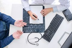 Professor doctor recommend report a method with patient treatment, results on examine a picture brain x-ray film about. The problem of the patient while working royalty free stock photo