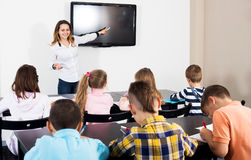 Professor and elementary age children Royalty Free Stock Photo