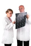 Professor explain to student. Old professor explain to a young female medical student royalty free stock photo
