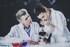 Professor Explains Student About using Microscope. Professor Explain Student About Using Microscope. Scientists Doing Some Researches. Educational Concept Royalty Free Stock Photo