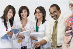 Professor With Female Students In Science Lab Royalty Free Stock Photography