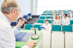 Professor giving medicine lecture to doctors Royalty Free Stock Photos