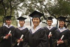 Professor and Graduates Stock Images