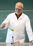 Professor heated chemicals in a laboratory Royalty Free Stock Images