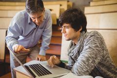 Professor helping a student in classroom Royalty Free Stock Photo