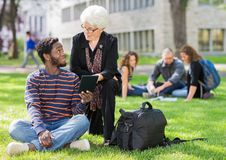 Professor Helping Student on Digital Tablet Royalty Free Stock Photo