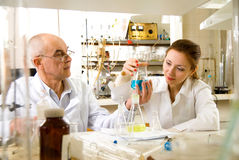 Professor and his assistant in the laboratory Stock Photo
