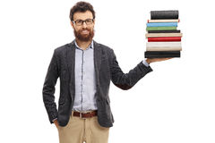 Professor holding a stack of books. Isolated on white background stock photography