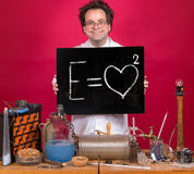Professor in the laboratory. Shows a blackboard with mathematical formula royalty free stock photo