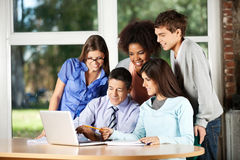 Professor With Laptop Explaining Students In Royalty Free Stock Photography