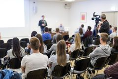 Professor lecturing in lecture hall at university. royalty free stock photo