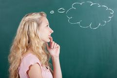 Professor Looking Away With Thought Bubble On Chalkboard Royalty Free Stock Photos