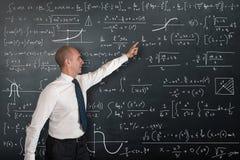 Mathematics Professor at the blackboard. Professor of Mathematics at the blackboard royalty free stock images