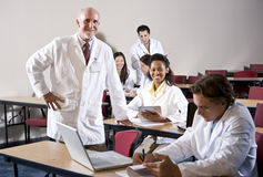 Professor with medical students in classroom Royalty Free Stock Photo