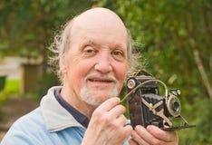 Professor met retro camera. royalty-vrije stock foto's