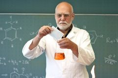 Professor mixes chemicals Royalty Free Stock Photo