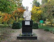 Statue of Professor Pavel Covaci - dendrological park Macea, Arad - Romania. Professor Pavel Covaci, former custodian, botanist seriously arranges the stock image