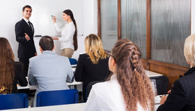 Professor and professionals at courses Royalty Free Stock Image