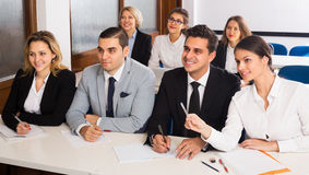 Professor and professionals at courses. Professor and professionals at extension business courses indoors royalty free stock photography