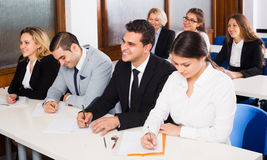 Professor and professionals at courses royalty free stock photo