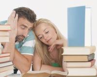 Professor que ajuda o estudante adolescente um em um Fotografia de Stock Royalty Free