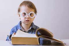 Professor reading a book. Humorous picture. Science, knowledge. Teaching, success, self development concept Stock Images