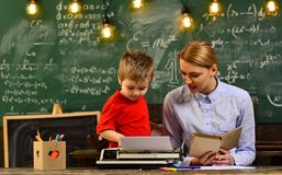 Professor and school student at the classroom in a school, Teacher sets high expectations for his students, Student royalty free stock photos