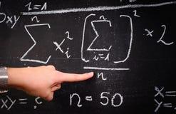 Professor showing formulas. On chalk board stock images