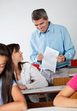 Professor Showing Paper To Student Royalty Free Stock Image