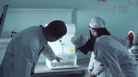 Professor showing the tester. Tutor showing pills solubility tester to the students stock footage