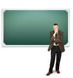 Professor standing near clean chalkboard Stock Image