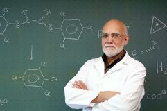 Professor stands in front of a blackboard Royalty Free Stock Image