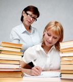 Professor and student. Female teacher supervises the student Royalty Free Stock Photos
