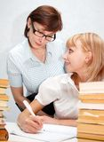 Professor and student. Female teacher supervises the student Stock Photos