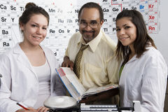 Professor With Students In Chemistry Lab Stock Photos