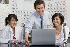 Professor With Students In Science Class Stock Photos