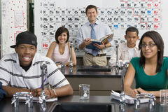 Professor With Students In Science Class Stock Images