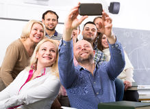 Professor taking a selfie with students Stock Photo