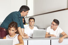 Professor talking to a male students Royalty Free Stock Images