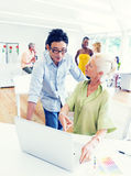 Professor Teaching a Senior Adult in the Office Royalty Free Stock Images