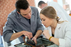 Professor teaching young students basics of hardware Stock Images