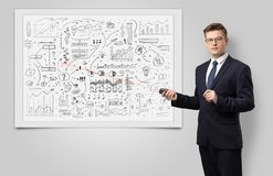 Professor on whiteboard teaching economy. Professor with laser pointer teaching business theories stock image