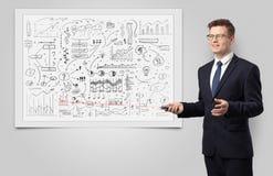 Professor on whiteboard teaching economy stock photo